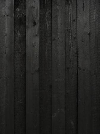 Black painted wood wall with vertical boards photo