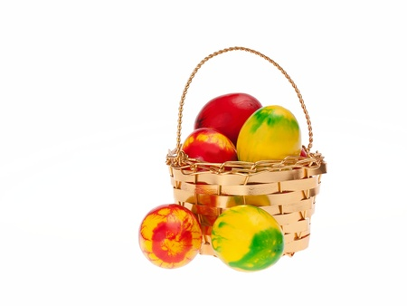 Colorful easter eggs in shiny golden basket photo