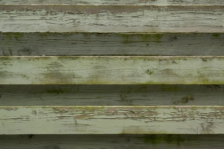 Close up photo of an old green painted fence photo