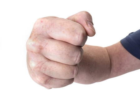 Close up photo of a large threatening fist isolated on white Stock Photo