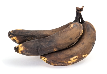 overripe: Old overripe bananas on a white background side view Stock Photo