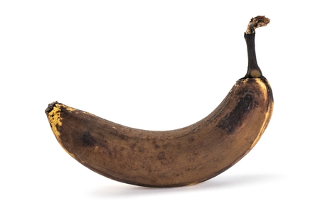 overripe: Side view of old overripe banana on white background