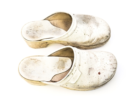 clogs: Old white woman clogs on white background seen from top