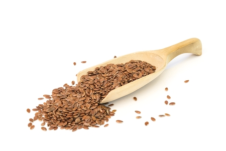 flaxseed: Wooden spoon with linseed on white background Stock Photo