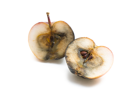 bad apple: Rotten apple cut in two halves on white background