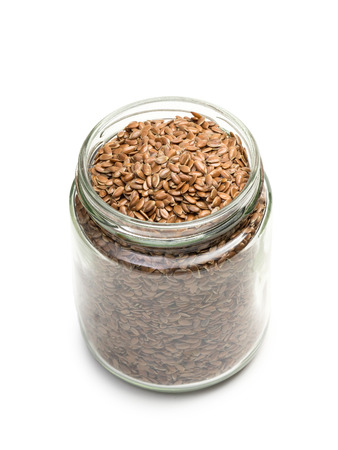 linseed: Glass jar with linseed or flax on a white background