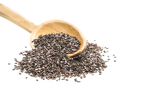 Wooden spoon with chia seeds seeds isolated on white Stock Photo