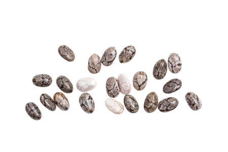 Close up of some healthy chia seeds spread out and isolated on white background