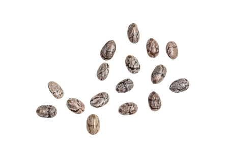 Small group of chia seeds spread out and isolated on white background