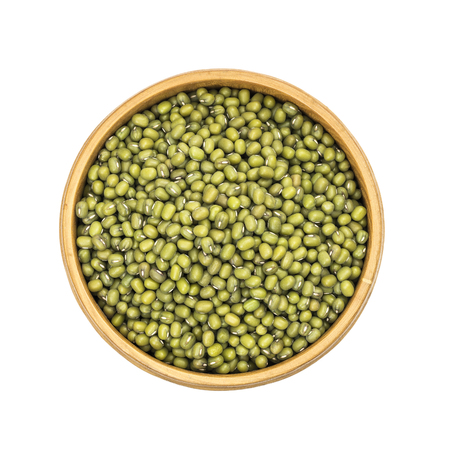 Mung beans in a wooden bowl seen directly from above and isolated on white