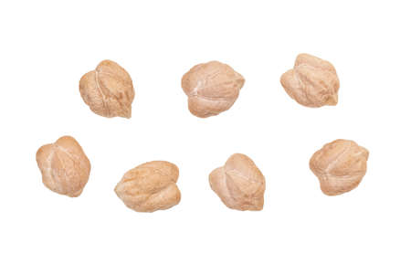 Macro of seven raw chickpeas seen directly from above and isolated on white background