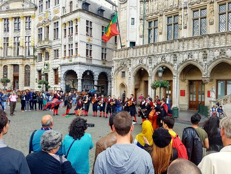 Brussels, Belgium. Juy, 2016. A group of portuguese university students playing instruments and singing at the Grand Place of Brussels. Members of university tuna