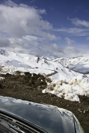 Reflected snow landscape in the bonet of a green car  Vall de Bo�,�, Lleida, in the autonomous community of Catalonia, northern Spain   Stock Photo - 17067757