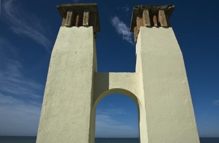 smokestacks: Arched smokestacks beside the sea