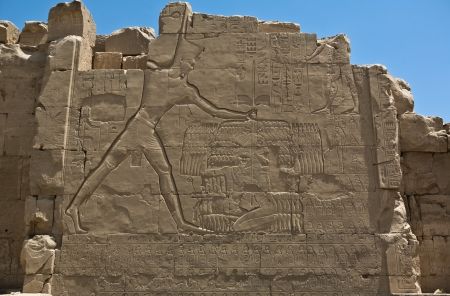 slaying: Pharaoh Tutmosis III probably, slaying his enemies  A carving at one of the pylons of the Karnak Temple in Luxor, Egypt