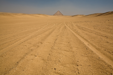Red Pyramid on desert photo