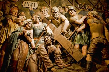 polychrome: Crucifixion scene in polychrome relief Stock Photo