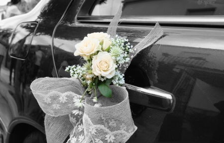 Door of black wedding car with flowers and white bow Stock fotó