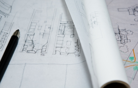 Pencil over interior planning document close up on an architect studio room photo