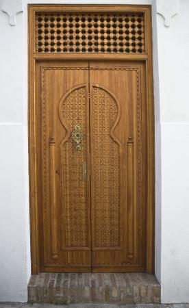 jewish quarter: Wooden door at Jewish Quarter of Cordoba , Spain Stock Photo