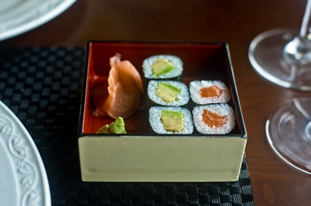 Assorted japanese food served a black wooden box photo