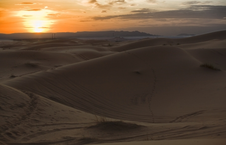 erg: Erg Chebbi is one of Moroccos two Saharan ergs – large dunes formed by wind-blown sand –. The other is Erg Chigaga near Mhamid. Its distinctive dunes reach a height of up to 150 meters. The composite erg spans an area of 22 kilometers from north to