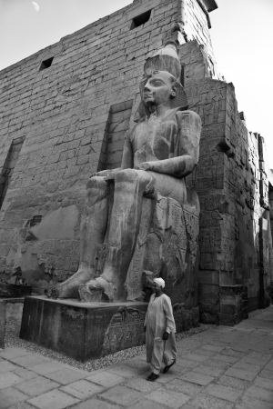 past civilizations: LUXOR, EGYPT - JULY 18  Sideways shot of a sitting pharaonic statue at the ancient Luxor Temple  On July 18, 2010 Luxor, Egypt Editorial