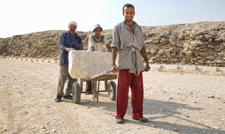 SAQQARA, EGYPT - JUL 21  Unidentified men work for restoration of Saqqara Pyramid area, on July 21, 2010, Saqqara, Egypt