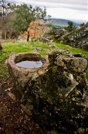 parapet: Abandoned granite parapet of a well at Pedroso de Acim village, Caceres, Spain