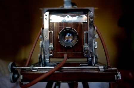 bellows: Old bellows camera standing over wooden tripod Stock Photo