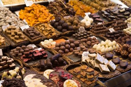 boqueria: Gourmet chocolate on display in the trasditional local market of La Boqueria,  Barcelona, Spain
