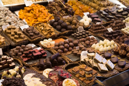 Gourmet chocolate on display in the trasditional local market of La Boqueria,  Barcelona, Spain