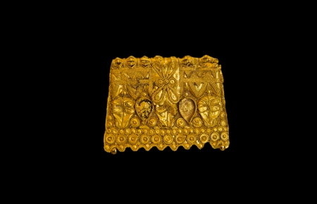 Golden lusitan ear ring isolated over black background made by Lusitanians  in the 6th century BC, people placed in Badajoz, Spain