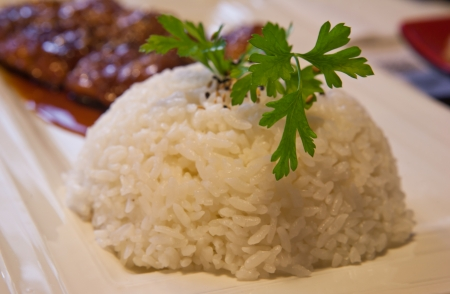 japanesse: Boiled Rice with parsley branch as garnish in  japanesse restaurant Stock Photo