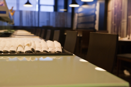 Interior of a empty modern japanese restaurant. Forniture, tableware and decoration