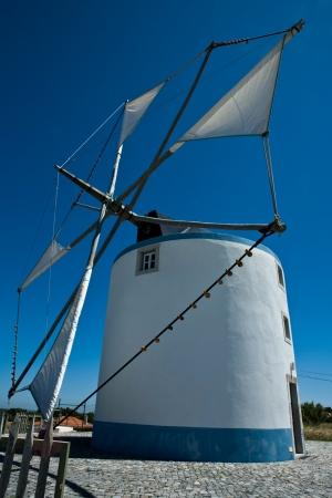 traditonal: Traditonal windmill in the countryside from Sesimbra, Portugal Stock Photo