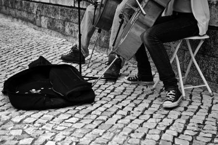 Street girl musician playing on violoncello, Lisboa, Portugal