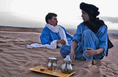 ZAGORA, MOROCCO - JUNE 14  Unidentified beber natives preparing tea over sand on June 14, 2010, Zagora, Morocco Editorial