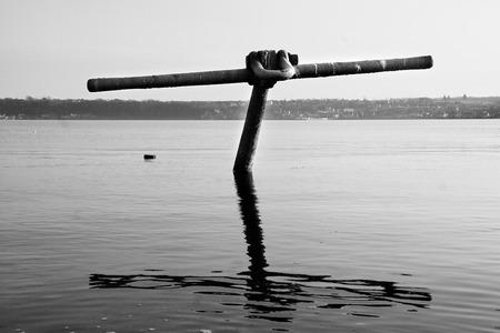View of huge half sunken anchor in North Queensferry Fife, Scotland photo