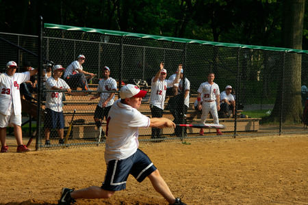 NEW YORK CITY - JUNE 23  Baseball team playing at Heckscher Ballfields in Central Park on June 23, 2008 There are 26 softball and baseball fields open to the public in Central Park