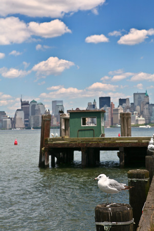 liberty island: Liberty Island pier in front of Manhattan, New York Harbor, USA Stock Photo