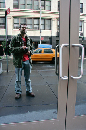 manhattan mirror new york: Male photographer taking a picture to himself  in Soho on June 23, 2008 in Manhattan, New York , NY