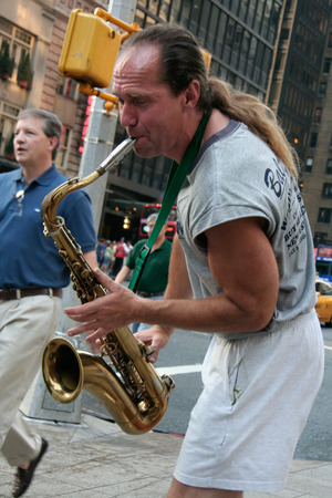 NEW YORK, USA - JUNE 23, 2008  A man playing saxophone in New York City streets on June 23, 2008