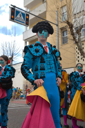 bullfighters: BADAJOZ, SPAIN, MARCH 4  Performers dressed up as bullfighters take part in the Carnival parade of comparsas at Badajoz City, on March 4, 2014  This is one of the best carnivals in Spain, renown by all the national news media and especially highlighting m Editorial