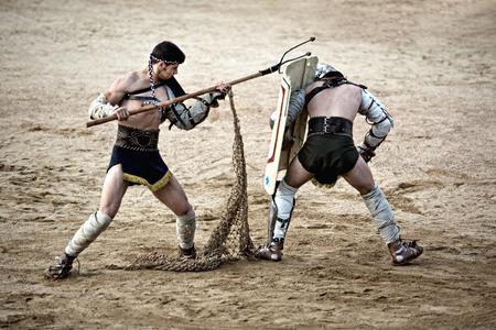 wrestlers: MERIDA, SPAIN – APRIL 5  performing of gladiators fighting of Merida Editorial