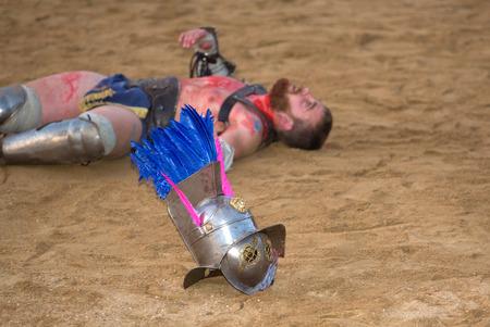 semicircular: MERIDA, SPAIN – APRIL 5  performing of gladiators fighting of Merida Editorial