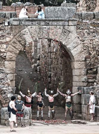 wrestlers: MERIDA, SPAIN – APRIL 5  Legionary soldier taking part on the performing of gladiators fighting of Merida Editorial