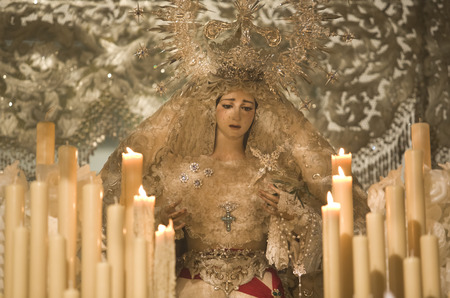 Statue of Madonna, the Virgin Mary in the Easter of Cordoba, Spain. These Pasos are carried in procession by Costaleros during the Easter Holy Week Festival photo