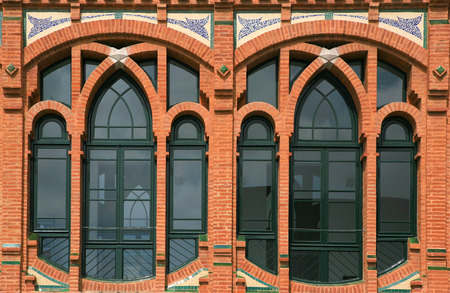 Windows detail of a modernism red brick building  Barcelona, Spain Stock Photo