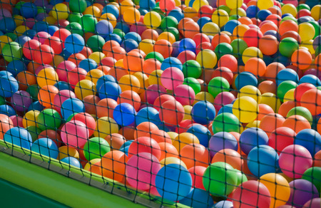 playcentre: Photo of a playground for children, full of colorful plastic balls behind the net
